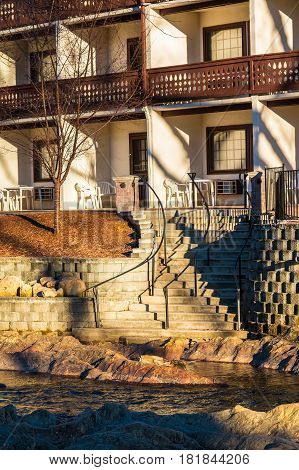 The part of facade of the hotel and stairs on the embankment of the Chattahoochee river Helen USA