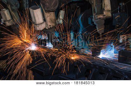 Test run robot is welding in factory.