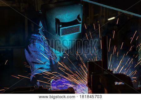 Close up welder in factory welding automotive part in factory