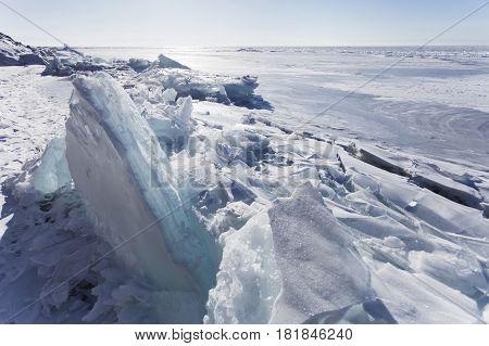 Turquoise Ice Floes Of Lake Baikal. Winter Landscape