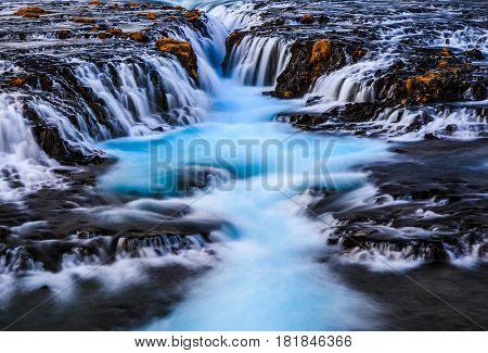Bruarfoss blue water from glacier waterfall Reykjavik Iceland