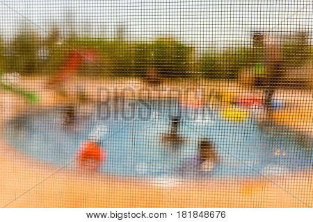Blurred abstract view of children playing on the pool
