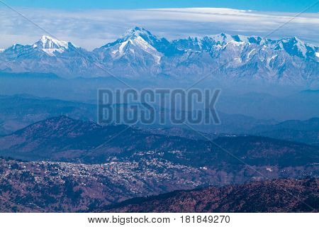 Trishul peak over viewing Ranikshet Town in the Himalayas. Elevation 7,120 Meter