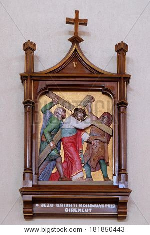 VAU I DEJES, ALBANIA - SEPTEMBER 30: 5th Stations of the Cross, Simon of Cyrene carries the cross, Mother Teresa cathedral in Vau i Dejes, Albania on September 30, 2016.