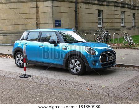 Light Blue Mini Cooper Car In Oxford