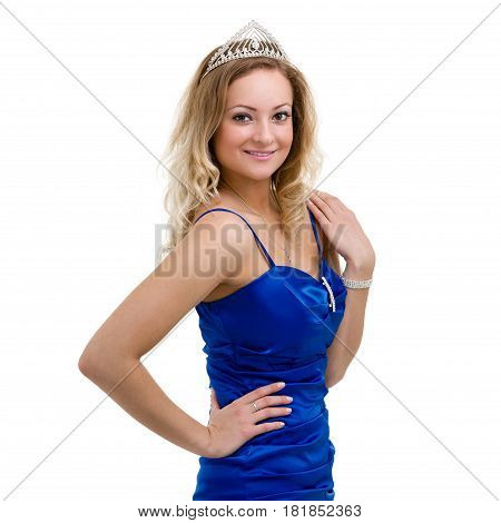 beautiful smiling girl in a blue dress with diadem on a white background