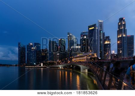 Singapore - April 14, 2017: Singapore skyline dusk and illuminated financial district night view Downtown Urban cityscape of Singapore. Modern skyscrapers of business district Marina Bay