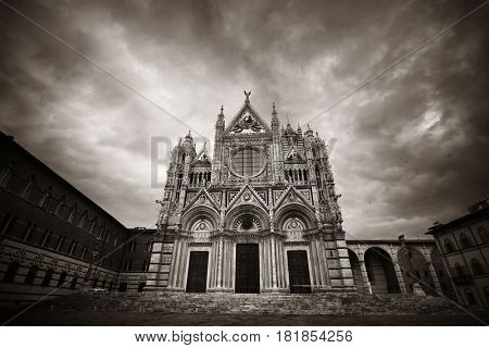 Siena Cathedral closeup as the famous landmark in medieval town in an overcast day in Italy.