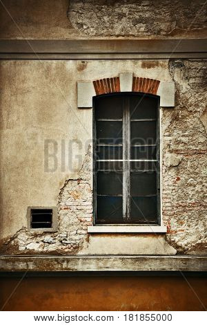 Vintage window with brick texture closeup in medieval Town Lucca in Italy.