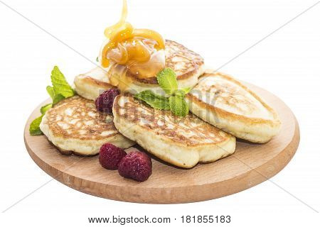 Cheese pancake is a flat cake often thin and round prepared from a starch-based batter that may also contain eggs milk cheese and butter and cooked on a hot surface such as a griddle or frying pan often with oil or butter.