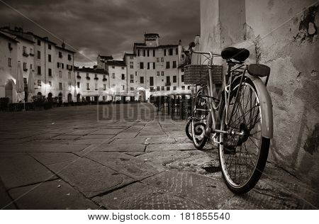 Piazza dell Anfiteatro in Lucca Italy with bike at night