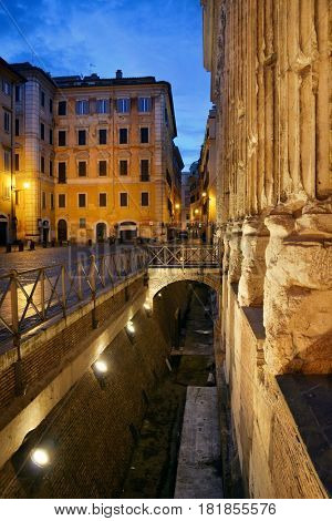 Street view with historical buidings and ruins in Rome, Italy.