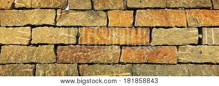 Old brickwork as background. Panoramic close-up photo.