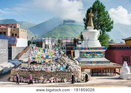 Yushu(jyekundo), China - Jul 13 2014: Tibetan Pilgrims Circle The Pagoda. Devotees Walk 3 Times Arou