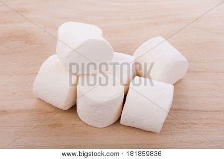CloseUp white marshmallows on wooden background. food
