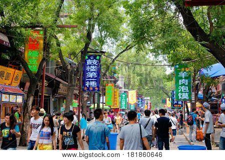 Xian, China - Jun 22 2014: Muslim Street In Xian. Hui People Are A Muslim Ethnic Minority In Xian.