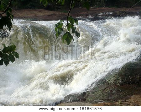Rushing water from hill rocks, heavy flow