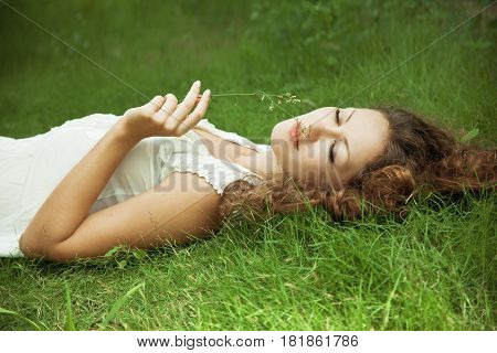 Young pretty woman lying on the grass