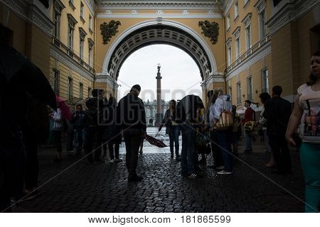 Tourists Hiding From The Rain Under The Arch Of The General Staff Building, St. Petersburg, Russia