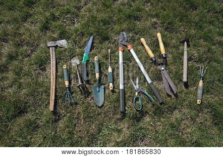 Garden tools: ax secateurs rakes saws rakes scissor etc.