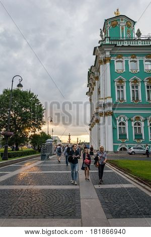 People Meet Gorgeous Sunset At The Walls Of The State Hermitage Museum