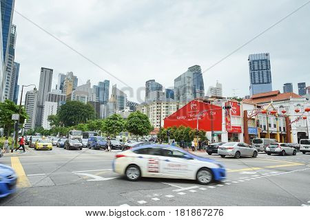 CHINATOWN SINGAPORE - JAN 20 2017: Singapore Chinatown district traffic in front of China Square on cloudy day.