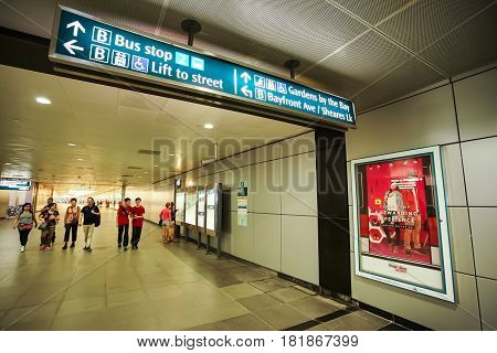 MARINA BAY SINGAPORE - JAN 20 2017: In the Marina Bay station people walking on walkway. This Singapore MRT station is the nearest station to go to The Marina Bay Sands.