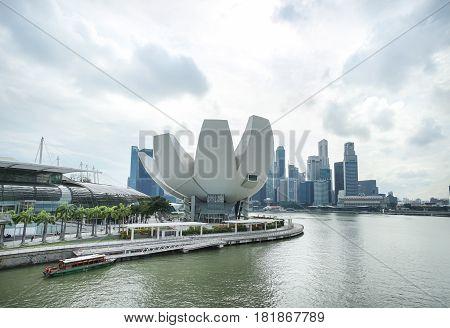 MARINA BAY SINGAPORE - JAN 20 2017: Landscape of ArtScience Museum nearly to The Shoppes at Marina Bay Sands. ArtScience Museum is a famous scene of Singapore travel destination.
