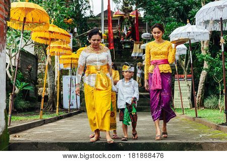 Balinese Family In Traditional Clothes During The Celebration Before Nyepi