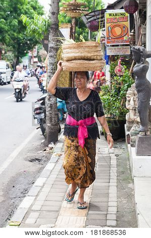 Senior Woman Carrying Basket On The Head