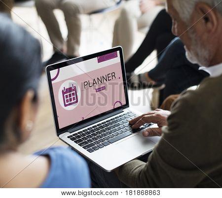 Illustration of personal organizer reminder calendar on laptop