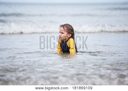 Beautiful Adorable little girl playing at beach