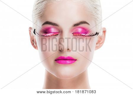 Portrait of young woman with fancy pink make-up isolated on white background