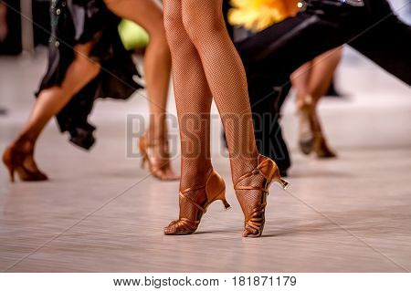 female dancer on her toes in stockings and heels shoes