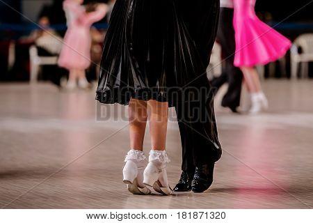 pair children athletes dancers on her toes dance flooring