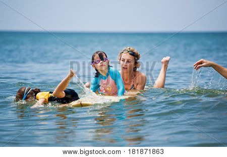 Family on vacation. Family Surfing. Summer holidays.