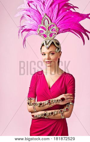 Beautiful Girl In Carnival Costume On Pink Background.