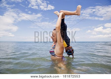 Mather and daughter playing in the sea