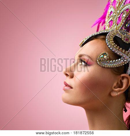 Beautiful Girl In Carnival  Headdress On Pink Background.
