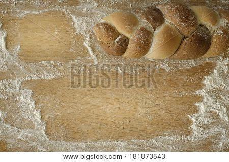 Braided Bread Lies On A Wooden Table With Flour