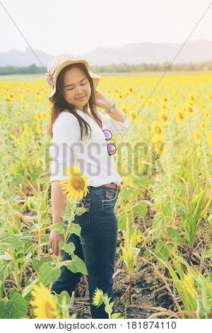 Happy Woman In Sunflower Field Smiling With Happiness