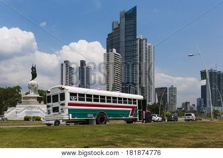Panama City Panama - March 17 2014: Colorful bus in an avenue in the downtown of Panama City in Panama.
