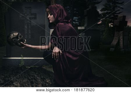 Beautiful sorceress in creepy cemetary. Fantasy concept.