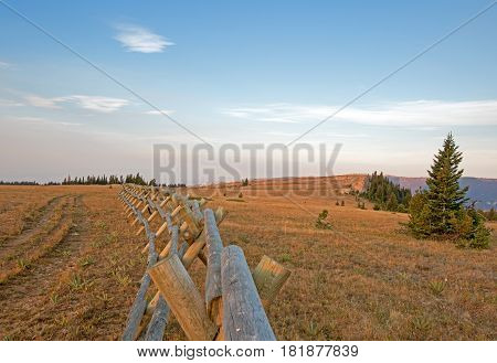 Split Rail Fence At Sunrise Above Lost Water Canyon In The Pryor Mountains Wild Horse Range On The M