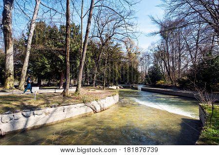 Munich Bavaria Germany.- March 28 2017. View of Schwabinger Bach at the Englischer Garten in Munich