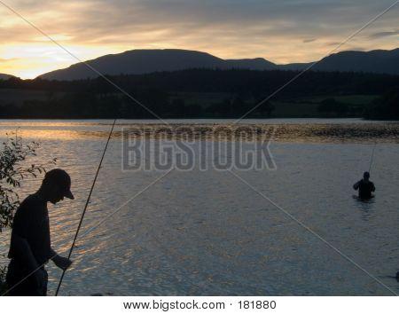 Rybolov při západu slunce