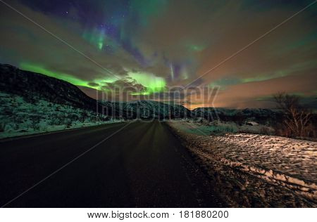 Amazing multicolored Aurora Borealis also know as Northern Lights in the night sky over Lofoten landscape Norway Scandinavia. Blurred as abstract nature background.