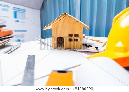Property Engineering Contractor Working Desk Tablet With Wood House Model And Business Object And Eq