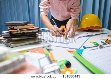 Business Engineer Contractor Working At His Desk Table In Office.