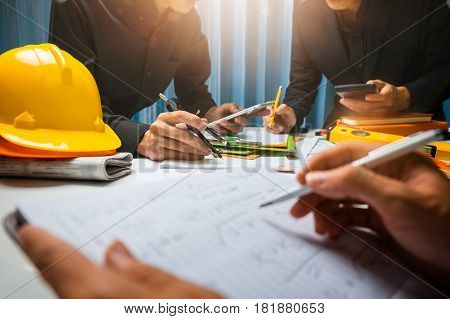 Teamwork Of Business Man Contractor Working Meeting In The Office Construction Site On Their Archite